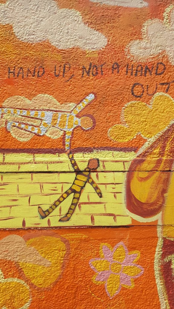 A hand up, not a hand out artwork in Manchester